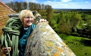 Canon Sue Booys abseils the tower